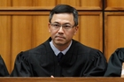 Judge Derrick Watson rejected the claims that the travel ban is about national security. Photo / AP