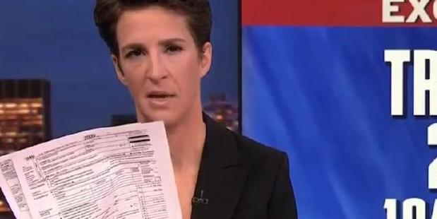 Loading Maddow holds up copies of the 1040 document. Photo / MSNBC