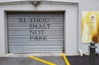 Spotted on a garage next to St John's Presbyterian Church in Willis St, Wellington. Photo / Supplied
