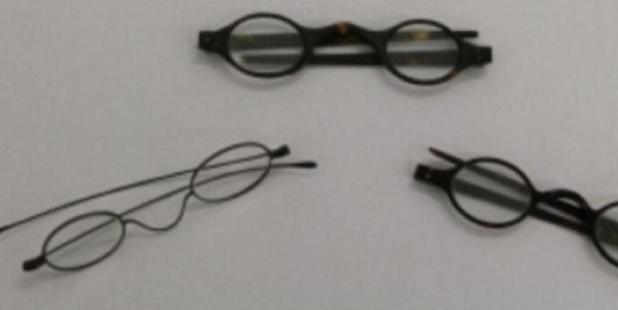 The wire-framed glasses (left) and two tortoiseshell pairs that were tested by the British Library.