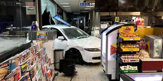 A white Mazda Atenza remains in place after the ram raid just after midnight today. Photo/Facebook