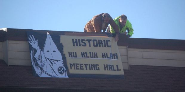 Loading City officials take down a KKK sign from a vacant building downtown in Dahlonega, Georgia. Photo/The Dahlonega Nugget Facebook