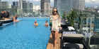 Lucy Casley checks out the rooftop pool and bar at the Liberty Central Saigon Citypoint, in Ho Chi Minh City.