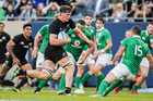 Scott Barrett on his way to scoring a try against Ireland in a standout debut for the All Blacks. Photo / Photosport