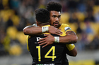 Hurricanes' Vince Aso (L) celebrates a try with teammate Ardie Savea. Photosport