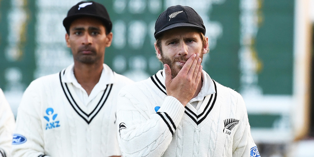 Kane Williamson leads his team from the field after defeat on day three. Photo / photosport.nz
