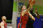 Canterbury Rams player Jeremy Kendle lays it up over Nnanna Egwu. Photo / Photosport