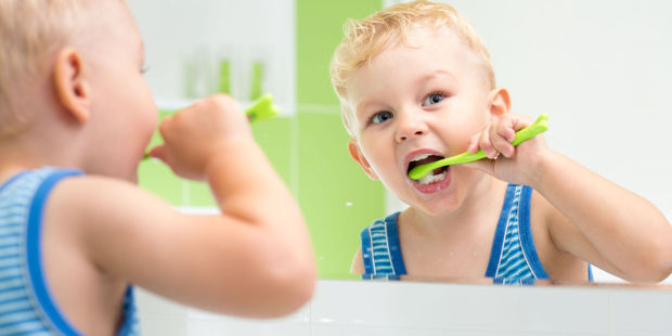 More than half of Kiwis surveyed are brushing their teeth incorrectly. Photo / 123RF