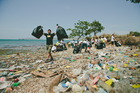 Ryley Webster assists the clean-up of Fairfax Harbour in Port Moresby. Photo / Striped Trees Productions