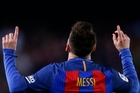 Lionel Messi scored once in each half to help take the game away from Valencia.  Photo / AP