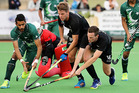 New Zealand's Harry Miskimmin and Jonty Keaney challenge for the ball in front of goal. Photo / Photosport