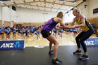 Katrina Grant and Courtney Tairi take Mt Albert Grammar School students through a netball fitness session in Auckland today. Photo/Supplied.
