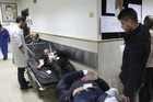 In this photo released by the Syrian official news agency SANA, Syrian injured men wait to receive medical treatments after they were wounded in a Damascus attack last week. Photo / AP