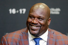 Shaquille O'Neal smiles as he talks to reporters during an NBA basketball news conference. Photo / AP