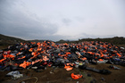 Piles of lifejackets used by refugees and migrants lie at a dump in Molyvos village, on the northeastern Greek island of Lesbos. Photo / AP