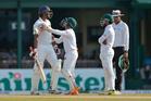 Bangladeshi captain Mushfiqur Rahim, second left, tries to stop an argument between Sri Lankan batsman Suranga Lakmal, left and fielder Sabbir Rahman. Photo / AP