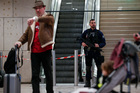 A riot police officer patrols inside Orly airport, south of Paris, as flights resume yesterday. Photo / AP