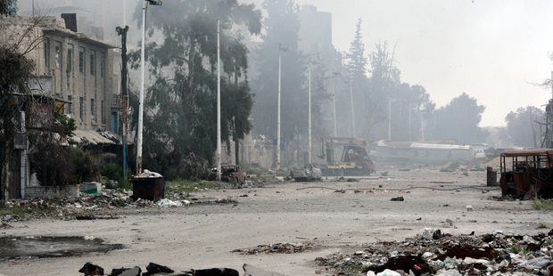 In this photo released by the Syrian news agency SANA, damaged and blocked street where clashes erupted between Syrian regime forces and rebels, east Damascus. Photo / AP