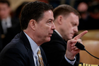 FBI Director James Comey, left, and National Security Agency Director Michael Rogers, testify on Capitol Hill. Photo / AP