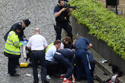 Police and emergency workers respond to the terrorist attack in Westminster. Photo / AP