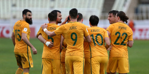 The Socceroos celebrate after scoring a goal against Iraq. Photo / AP