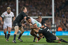 England's Manu Tuilagi tries to break through All Black defence during a 2014 test at Eden Park. Photo / Brett Phibbs