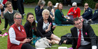 Labour MPs, from left, Ruth Dyson, Jacinda Adern, Annette King and Grant Robertson during the Equal Pay Day picnic on the front lawn at Parliament, Wellington. 10 November 2015 New Zealand Herald Pho