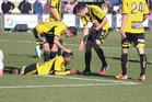 Wellington Phoenix team members congratulate Roy Krishna. Photo / Rory Scott