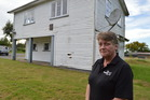 Blackball St John volunteer Denise Kilpatrick in front of the ambulance hall, which is being sold off by the St John Grey District Area Committee. Photo / Greymouth Star
