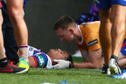 Sione Mata'utia of the Knights is treated for concussion during the Knight's clash against the Melbourne Storm last year. Photo / Getty Images.