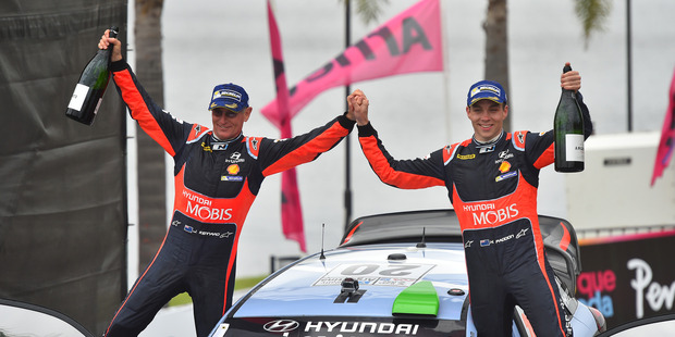 Hayden Paddon and John Kennard celebrate their victory at WRC Argentina 2016. Photo / Getty Images