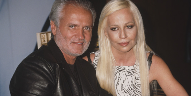 Italian fashion designers Gianni (1946 - 1997) and Donatella Versace at the launch for their new fragrance 'Versace's Blonde', USA, circa 1996. Photo / Getty