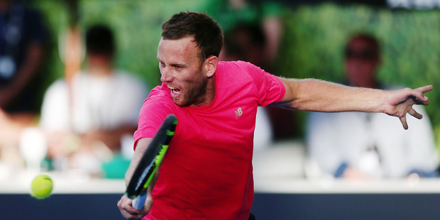 Michael Venus reaches for a backhand at the ASB Classic. Photo / Getty Images