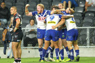 Bulldogs players celebrate after scoring a try against the Warriors in Dunedin. Photo / Getty Images