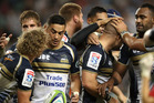 The Brumbies celebrate a try against the Waratahs. Photo / Getty