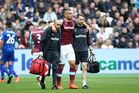 Winston Reid of West Ham is helped off by the West Ham medics. Photo / Getty