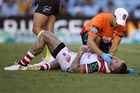 Josh Dugan receives attention from the trainer during the round three NRL match between the Cronulla Sharks and the St George Illawarra Dragons. Photo / Getty