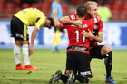 Brendon Santalab of the Wanderers celebrates with teammate Mitch Nichols after scoring his second goal. Photo / Getty