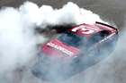 Ryan Newman does a burnout after winning the Camping World 500. Photo / Getty Images