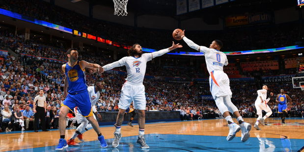 Notorious stat-padder Russell Westbrook steals a rebound away from Steven Adams. Photo / Getty