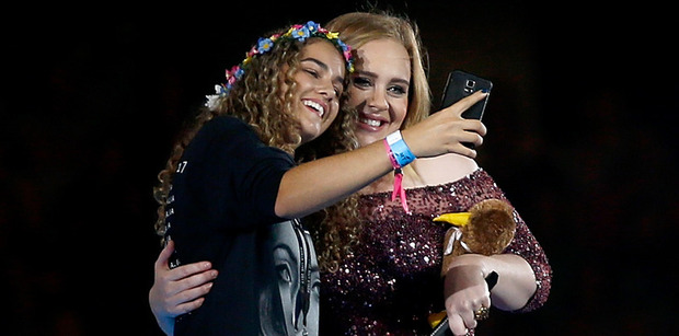 Loading Teagan scores a selfie with Adele during her Mt Smart Show in Auckland last night. Photo/Getty