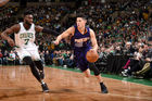 Devin Booker of the Phoenix Suns goes to the basket against the Boston Celtics. Photo . Getty
