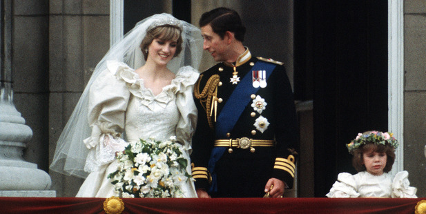 The Prince and Princess of Wales pose on the balcony of Buckingham Palace on their wedding day. Photo / Getty