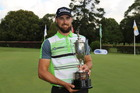 Daniel Pearce poses with the trophy. Photo / Supplied