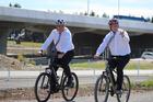 Racing Minister Nathan Guy, left, and Prime Minister Bill English enjoy a bike ride. Photo / David Haxton