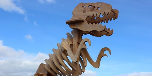 IMPOSING: A wood-cut dinosaur at the Hyde Park Village.