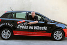 Geeks on Wheels chief executive Matthew Carr-Gomm in one of its signwritten cars. Photo/Supplied