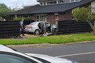 A car crashed through a fence and into a house after a police pursuit in Onehunga. Photo/Supplied