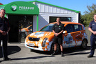 Owner John Sherman (left), manager Allan Peters (middle), and other owner Paul Rod (right) outside Pegasus Rental Cars in Whanganui. PHOTO/ STUART MUNRO