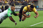 Ngani Laumape dives for the tryline during the Hurricanes' win over the Highlanders. Photo / photosport.nz